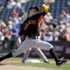 Photo - San Francisco Giants' Tim Lincecum works against the Kansas City Royals in the first inning of a spring training baseball game, Friday, March 7, 2014, in Surprise, Ariz. (AP Photo/Tony Gutierrez)