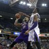 Phoenix Suns forward P.J. Tucker, left, drives against Sacramento Kings forward Thomas Robinson during the first quarter of an NBA basketball game in Sacramento, Calif., Wednesday, Jan. 23, 2013. (AP Photo/Rich Pedroncelli)