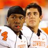 Photo - OSU: Quarterbacks Bobby Reid (14) and Zac Robinson stand together in the bench area in the second half during the college football game between Oklahoma State University and Baylor University at Floyd Casey Stadium in Waco, Texas, Saturday, Nov. 17, 2007. BY MATT STRASEN, THE OKLAHOMAN ORG XMIT: KOD