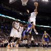Oklahoma City\'s Russell Westbrook (0) goes to the basket during the NBA basketball game between the Oklahoma City Thunder and the Golden State Warriors at the Oklahoma City Arena, Tuesday, March 29, 2011. Photo by Bryan Terry, The Oklahoman