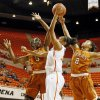 Oklahoma State\'s Kendra Suttles (31) takes a shot between Texas\' Nneka Enemkpali (3) and Texas\' Celina Rodrigo (2) during a women\'s college basketball game between Oklahoma State University (OSU) and the University of Texas at Gallagher-Iba Arena in Stillwater, Okla., Saturday, March 2, 2013. Photo by Nate Billings, The Oklahoman