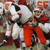 Oklahoma\'s D.J. Wolfe (25) brings down Oklahoma State\'s Damian Davis (85) during the first half of the college football game between the University of Oklahoma Sooners (OU) and the Oklahoma State University Cowboys (OSU) at the Gaylord Family-Memorial Stadium on Saturday, Nov. 24, 2007, in Norman, Okla. Photo By NATE BILLINGS, The Oklahoman