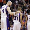 Phoenix Suns\' Marcin Gortat (4), of Poland, walks with Sebastian Telfair (31) to the bench after Telfair turned the ball over during the second half of an NBA basketball game against the New York Knicks, Wednesday, Dec. 26, 2012, in Phoenix. The turnover gave the Knicks the game-winning shot on the next possession for a 99-97 victory. (AP Photo/Matt York)