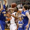 Stephen Clark of Douglass is fouled as he goes between Piedmont\'s Connor McFall, at right, and Grant Gipson during a Class 4a boys basketball state tournament game in Midwest CIty, Okla., Thursday, March 8, 2012. Photo by Bryan Terry, The Oklahoman