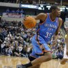 Oklahoma City\'s Kevin Durant (35) drives to the basket during the preseason NBA game between the Dallas Mavericks and the Oklahoma City Thunder at the American Airlines Center in Dallas, Sunday, Dec. 18, 2011. Photo by Sarah Phipps, The Oklahoman