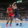 Photo - Los Angeles Clippers center DeAndre Jordan, left, drives the lane for shot as Denver Nuggets center Timofey Mozgov, of Russia, covers in the first quarter of an NBA basketball game in Denver on Monday, March 17, 2014. (AP Photo/David Zalubowski)