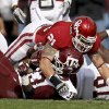 Oklahoma\'s Tom Wort (21) brings down Texas A&M\'s Christine Michael (33)during the college football game between the Texas A&M Aggies and the University of Oklahoma Sooners (OU) at Gaylord Family-Oklahoma Memorial Stadium on Saturday, Nov. 5, 2011, in Norman, Okla. Oklahoma won 41-25. Photo by Bryan Terry, The Oklahoman