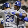 Photo - Los Angeles Dodgers' Yasiel Puig, right, is greeted by Adrian Gonzalez (23) after hitting a solo home run against the New York Mets during the sixth inning of a baseball game, Wednesday, May 21, 2014, in New York. (AP Photo/Julie Jacobson)