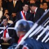 Photo - In this Aug.15, 2013 photo, Paraguay's President Horacio Cartes, top center left, listens to Vice President Juan Afara, right, during a military parade in Asuncion, Paraguay. Cartes wants open-ended, blanket approval to send troops to the northern department of San Pedro against the Paraguayan People's Army without having to declare a state of emergency. The government blames the guerrilla group for the recent deaths of five farmhands. Human rights groups fear the step, but Cartes has plenty of support. House approval was expected Wednesday night, Aug. 21, 2013, before a Senate vote Thursday afternoon. (AP Photo/ Cesar Olmedo)