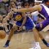 Golden State Warriors\' Harrison Barnes (40) passes around Phoenix Suns\' Jared Dudley during the first half of an NBA basketball game on Friday, April 5, 2013, in Phoenix. (AP Photo/Matt York)
