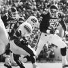 OU linebackers Brian Bosworth (44) and Dante Jones (50) converge on Oklahoma State\'s Thurman Thomas before he can find any room to run as the Sooners beat the Cowboys 19-0 during the Bedlam football game of Oct. 18, 1986 in Norman, Okla. Staff photo by George R. Wilson