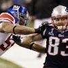 New York Giants linebacker Michael Boley, left, pushes New England Patriots wide receiver Wes Welker (83) out of bounds during the first half of the NFL Super Bowl XLVI football game Sunday, Feb. 5, 2012, in Indianapolis. (AP Photo/David Duprey) ORG XMIT: SB239