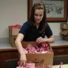 Norman Regional Health System Teen Hero Ashley Taylor puts Valentine goodie bags into a box so they can be distributed to patients. Community Photo By: Lisa Beckloff, NRHS Submitted By: Lisa, Norman