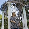 In this Monday, Oct. 29, 2012 photo, Carole Delhorbe poses in a gazebo her husband built on their home in Ruskin, Fla. Delhorbe, a registered Republican who is a President Barack Obama supporter, has a simple financial formula: Her two adult sons are better off, so she is, too. She says she could tell the economy was picking up when the two, one 32, the other 27, stopped asking her for money.