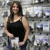 Lisa Looper, owner of Flashbang Holsters poses for a photo at H&H Shooting Sports on Friday. Flashbang Holsters is a subsidiary of Looper Leather and sells holsters designed for use alongside women\'s clothing. Photo by KT King, The Oklahoman