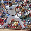 Photo -   Texas Rangers pitcher Colby Lewis throws against the Houston Astros during the first inning of a baseball game, Sunday, June 17, 2012, in Arlington, Texas. (AP Photo/Tim Sharp)