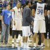 Photo - Dallas Mavericks owner Mark Cuban, far left, stands on the court during an official review at the end of a NBA basketball game against the Golden State Warriors, Tuesday, April 1, 2014, in Dallas. Golden State won 122-120 in overtime. (AP Photo/Matt Strasen)