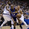 Los Angeles Lakers guard Kobe Bryant (24) drives against Dallas Mavericks\' O.J. Mayo, left, and Shawn Marion, right, in the first half of an NBA basketball game Sunday, Feb. 24, 2013, in Dallas. (AP Photo/Tony Gutierrez)
