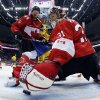 Photo - Canada goaltender Carey Price makes a save during the first period of the men's gold medal ice hockey game against Sweden at the 2014 Winter Olympics, Sunday, Feb. 23, 2014, in Sochi, Russia. (AP Photo/Julio Cortez, Pool)