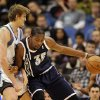 Photo - Minnesota Timberwolves' Andrei Kirilenko, left, of Russia, defends against Oklahoma City Thunder's Kevin Durant (35) during the first quarter of an NBA basketball game at the Target Center on Thursday, Dec. 20, 2012, in Minneapolis. (AP Photo/Hannah Foslien) ORG XMIT: MNHF103