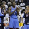 Oklahoma City Thunder players Royal Ivey, left, Serge Ibaka (9) and Eric Maynor, right, celebrate in the final moments of the third overtime period against the Memphis Grizzlies in Game 4 of a second-round NBA basketball playoff series on Tuesday, May 10, 2011, in Memphis, Tenn. Oklahoma City won 133-123 in triple overtime. (AP Photo/Lance Murphey)