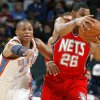 Oklahoma CIty\'s Russell Westbrook goes for the ball beside New Jersey\'s Stephen Graham during the NBA basketball game between the Oklahoma City Thunder and the New Jersey Nets at the Oklahoma City Arena, Wednesday, Dec. 29, 2010. Photo by Bryan Terry, The Oklahoman