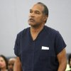 Photo - File-This Dec. 5, 2008 file photo shows O.J. Simpson speaking during his sentencing  at the Clark County Regional Justice Center in Las Vegas. Simpson is heading back to the Las Vegas courthouse where he was convicted of leading five men in an armed sports memorabilia heist to ask a judge for a new trial because, he says, the Florida lawyer he paid nearly $700,000 botched his defense.  (AP Photo/Isaac Brekken, File)