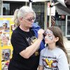 Jan Cates paints Presley Turley\'s face during Saturday\'s Bethany 66 Festival. PHOTO BY M. TIM BLAKE, FOR THE OKLAHOMAN