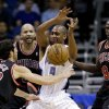 Orlando Magic guard Arron Afflalo (4) loses control of the ball as he is guarded by Chicago Bulls\' Kirk Hinrich (12), Carlos Boozer, rear, and Luol Deng (9), of Sudan, during the first half of an NBA basketball game, Wednesday, Jan. 2, 2013, in Orlando, Fla. (AP Photo/John Raoux)