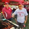 Tony Gonzalez, Choctaw, cooks as Jeff Barsotti watches before the college football game where the University of Oklahoma Sooners (OU) play the University of Louisiana Monroe Warhawks at Gaylord Family-Oklahoma Memorial Stadium in Norman, Okla., on Saturday, Aug. 31, 2013. Photo by Steve Sisney, The Oklahoman