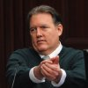 Photo - Michael Dunn, gestures on the stand in his own defense during his trial in Jacksonville, Fla., Tuesday, Feb. 11, 2014. Dunn is charged with fatally shooting 17-year-old Jordan Davis after an argument over loud music outside a Jacksonville, Fla. convenient story in 2012.(The Florida Times-Union, Bob Mack, Pool)