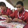University of Oklahoma Basketball players Cade Davis (left) and Steven Pledger sign autographs during fan fest before the college football game between the University of Oklahoma Sooners (OU) and Florida State University Seminoles (FSU) at the Gaylord Family-Oklahoma Memorial Stadium on Saturday, Sept. 11 2010, in Norman, Okla. Photo by Steve Sisney, The Oklahoman