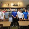 New Mt. St. Mary coach Andy Fisher with the Rockets\' seniors-to-be