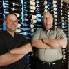 RESTAURANT: Billy Wilson, left and his dad Bill Wilson stand with the wine selection at Opus Prime Steakhouse in Oklahoma City, Oklahoma , Thursday, June 3, 2011. Photo by Steve Gooch ORG XMIT: KOD Steve Gooch - THE OKLAHOMAN