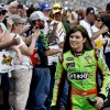 Photo - Danica Patrick smiles as she walks past fans during driver introductions before the NASCAR Sprint Cup Series auto race, Sunday, March 3, 2013, in Avondale, Ariz. (AP Photo/Ross D. Franklin)