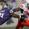 Oklahoma State\'s Kendall Hunter (24) runs past Kansas State\'s Brandon Harold (91) during the first half of the college football game between the Oklahoma State University Cowboys (OSU) and the Kansas State University Wildcats (KSU) on Saturday, Oct. 30, 2010, in Manhattan, Kan. Photo by Chris Landsberger, The Oklahoman