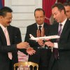 CEO of Airbus, French Fabrice Bregier, right, hands over an Airbus 320 model to CEO of Lion Air, Indonesian Rusdi Kirana, left, while France\'s President Francois Hollande stands behind during a signing ceremony at the Elysee Palace in Paris, Monday, March 18, 2013. Indonesian airline Lion Air is to buy 234 short to medium range aircraft from Airbus for 18.4 billion Euro($24 billion), in what is being billed as the biggest civilian deal in the history of the aircraft manufacturer. The contract was announced Monday at the French presidential palace, a sign of the deal\'s importance to the government. Airbus said it would secure 5,000 jobs at a time when French unemployment hovers around the 10 percent mark. (AP Photo/Michel Euler)
