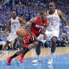 Miami\'s Mario Chalmers (15) drives past Oklahoma City\'s Kendrick Perkins (5) during Game 1 of the NBA Finals between the Oklahoma City Thunder and the Miami Heat at Chesapeake Energy Arena in Oklahoma City, Tuesday, June 12, 2012. Photo by Chris Landsberger, The Oklahoman