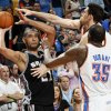 San Antonio\'s Tim Duncan (21) tries to pass the ball away from Oklahoma City\'s Nick Collison (4) and Kevin Durant (35) during the NBA basketball game between the Oklahoma City Thunder and the San Antonio Spurs at Chesapeake Energy Arena in Oklahoma City, Friday, March 16, 2012. San Antonio won, 114-105. Photo by Nate Billings, The Oklahoman