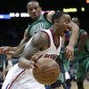 Photo - Atlanta Hawks guard Jeff Teague drives against Boston Celtics guard Avery Bradley during the first half of an NBA basketball game Friday, Jan. 25, 2013, in Atlanta. (AP Photo/John Bazemore)