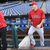 Photo - Los Angeles Angels' Mike Trout takes the field before the start of a baseball game with the Philadelphia Phillies, Tuesday, May 13, 2014, in Philadelphia. (AP Photo/Laurence Kesterson)