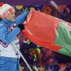 Photo - Gold medalist Alla Tsuper, of Belarus, poses with a Belarusian flag after a flower ceremony for the women's freestyle skiing aerials final at the Rosa Khutor Extreme Park, at the 2014 Winter Olympics, Friday, Feb. 14, 2014, in Krasnaya Polyana, Russia. (AP Photo/Jae C. Hong)