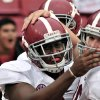 Photo -   Alabama running back Blake Sims, left, and teammate offensive linesman Ryan Kelly celebrate Sims' fourth-quarter touchdown against Arkansas in an NCAA college football game in Fayetteville, Ark., Saturday, Sept. 15, 2012. Alabama defeated Arkansas 52-0. (AP Photo/April L. Brown)