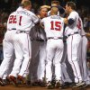 Atlanta Braves\' Chipper Jones (10) celebrates with teammates after hitting a game-winning, two-run home run in the 10th inning of a baseball game against the Philadelphia Phillies in Atlanta, Wednesday, May 2, 2012. Atlanta won 15-13. (AP Photo/John Bazemore)