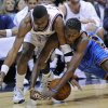 Photo - New Jersey Nets guard Keyon Dooling, left, and Oklahoma City Thunder guard Kyle Weaver battle for control of a loose ball during the first quarter of an NBA basketball game Monday,  Jan. 12, 2009 in East Rutherford, N.J. (AP Photo/Bill Kostroun) ORG XMIT: ERA101