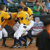 West Virginia players celebrate with Bobby Boyd (4), second from left, after he scored the winning run in the tenth inning during an NCAA baseball game between Oklahoma State and West Virginia in the Big 12 Baseball Championship tournament at the Chickasaw Bricktown Ballpark in Oklahoma City, Saturday, May 25, 2013. WVU beat OSU 6-5 in ten innings. Photo by Nate Billings, The Oklahoman