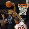 Kansas State\'s Jordan Henriquez (21) blocks the shot of Oklahoma\'s Amath M\'Baye (22) during an NCAA men\'s basketball game between the University of Oklahoma (OU) and Kansas State at the Lloyd Noble Center in Norman, Okla., Saturday, Feb. 2, 2013. Kansas State won, 52-50. Photo by Nate Billings, The Oklahoman