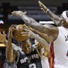 Photo - The Miami Heat's LeBron James (6) and Chris Andersen (11) defend San Antonio Spurs small forward Kawhi Leonard (2) during the first half of Game 2 of the NBA Finals basketball game, Sunday, June 9, 2013 in Miami. (AP Photo/Lynne Sladky)