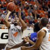 OSU\'s Brian Williams (4) takes a shot near KU\'s Elijah Johnson (15) and OSU\'s Markel Brown (22) in the first half during a men\'s college basketball game between the Oklahoma State University Cowboys and the University of Kansas Jayhawks at Gallagher-Iba Arena in Stillwater, Okla., Monday, Feb. 27, 2012. Photo by Nate Billings, The Oklahoman
