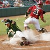 Baylor\'s Josh Ludy (30) slides home to score past OU\'s Tanner Toal (31) in the fourth inning during a Big 12 Baseball Championship tournament game between the Oklahoma Sooners and Baylor Bears at the Chickasaw Bricktown Ballpark in Oklahoma City,Thursday, May 24, 2012. OU won, 3-2. Photo by Nate Billings, The Oklahoman